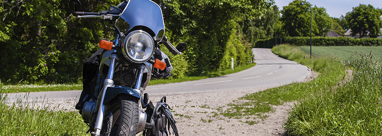 Motorcycle Insurance - Motorbike by side of the road