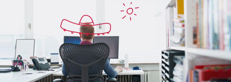 Man at a desk with a doodle of a hat and the sun