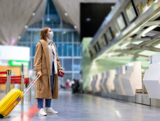 woman in the airport with luggage