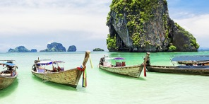 Row of boats in lagoon in Thailand