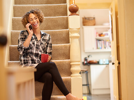 lady sitting on stairs talking on the phone