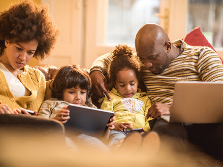 family using laptop, smart phone