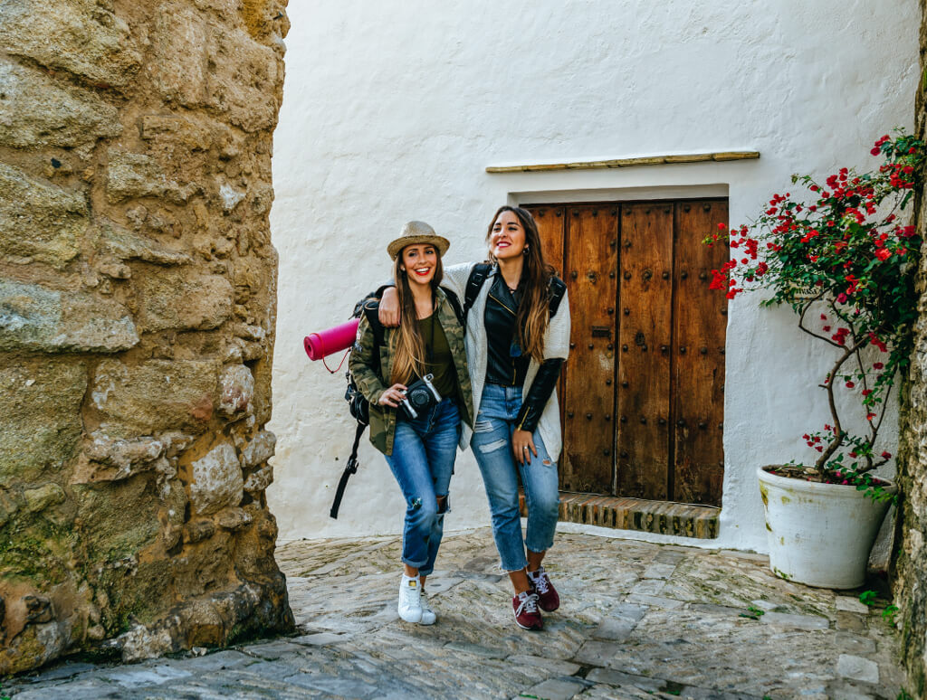 friends walking through cobbled streets